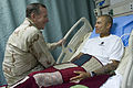 Defense.gov News Photo 110801-N-TT977-198 - Chairman of the Joint Chiefs of Staff Adm. Mike Mullen visits with U.S. Army Spc. Rosasgarza Francisco a patient at Craig Joint Theater Hospital.jpg