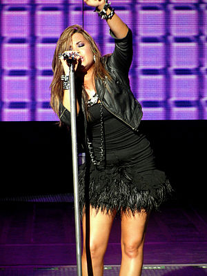 Demi Lovato: Stay Strong - Lovato performing during the Jonas Brothers Live in Concert World Tour in September 2010, about two months before the singer abrubtly withdrew from the tour.