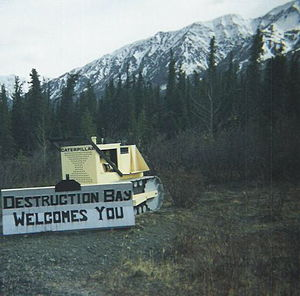 Destruction Bay - Welcome sign made on an old bulldozer