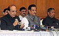Dinesh Trivedi addressing the press conference, jointly organised by the Railways and Maharashtra State, in Mumbai. The Chief Minister of Maharashtra, Shri Prithviraj Chavan and the Minister of State for Railways.jpg