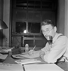 man at desk with pipe