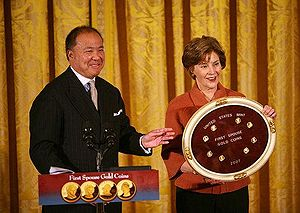Presidential $1 Coin Program - Director of United States Mint Edmund C. Moy and First Lady Laura Bush at the unveiling of Dolley Madison's First Spouse coin on November 19, 2007