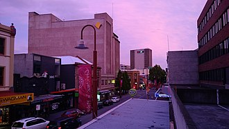 Hobart city centre - Looking south down Elizabeth Street towards the CBD at dusk.
