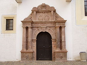"Architectural style - The rhyolitic tuff portal of the ""church house"" at Colditz Castle, Saxony, designed by Andreas Walther II (1584), is an example of the exuberance of ""Antwerp Mannerism""."