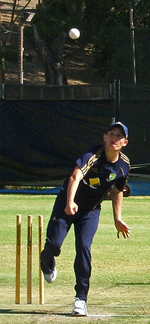 Erin Osborne - Osborne bowing in the nets.
