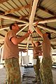 Exercise Talisman Sabre 2011, Australian Army soldier paint the ceiling of a gazebo at St. Christopher's Chapel.jpg