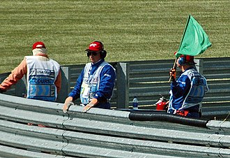 Motorsport marshal - A flag marshal at the 2005 United States Grand Prix