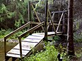FLT M27 11.3 mi - Bridge over E Branch Cold Spr Creek, 42' long, 2x6x48 deck boards, 3 2x10 stringers, tel pole posts, 2x6 hand rails, steel cross bars on slopes, 5' to drainage, 1997 - panoramio.jpg