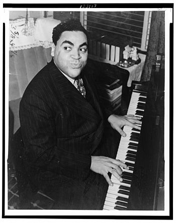 Fats Waller, three-quarter length portrait, se...