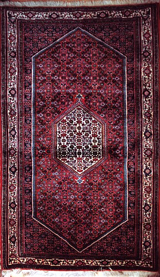 Bijar - A fine quality modern Bijar rug with a central medallion, herati motifs on a dark red ground and a seven-band border