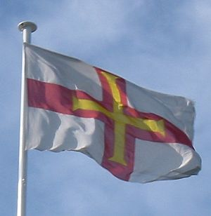 Flag of Guernsey flying in St. Peter Port