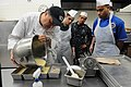 Flickr - Official U.S. Navy Imagery - Darryl Espinoza teaches Sailors how to make cakes..jpg