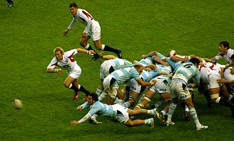 Rugby union gameplay - Scrum-half Agustín Pichot dive passing the ball from the back of a scrum.
