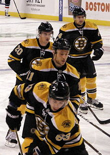 220px Four Boston players Brad Marchand