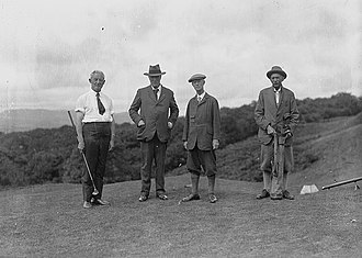 Golf - Four gentlemen golfers on the tee of a golf course, 1930s