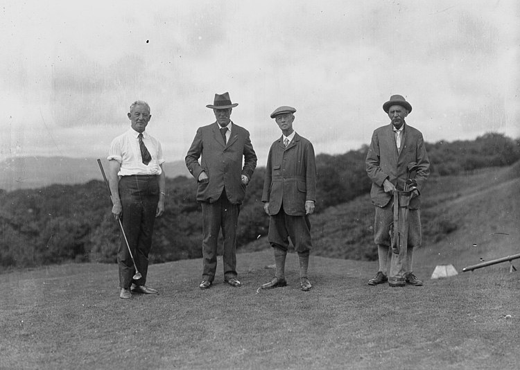 Four gentlemen golfers on the tee of a golf course (5014828806)