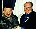 Gary Ackerman pinning his New York Big Apple pin on Jordan's King Abdullah II.jpg
