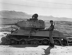 A destroyed tank with writing on it.