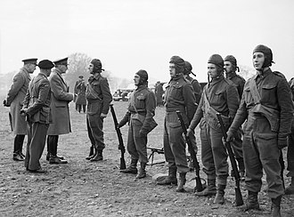 Operation Colossus - General Sir John Dill, Chief of the Imperial General Staff (CIGS), inspecting parachute troops at the Central Landing Establishment at RAF Ringway near Manchester, December 1940.