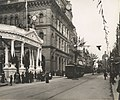 George Street, at intersection with Martin Place, Sydney (NSW), decorated for the visit of the Duke and Duchess of Cornwall and York. Shows colonnade of the 'Court of the Empire' (39612032322).jpg