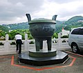 Giant Ding in car park. National Museum, Taipei.jpg