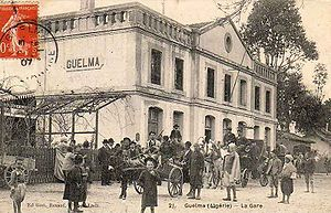 National Company for Rail Transport - People gather in front of Guelma's train station (19th century postcard)
