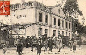 Guelma - People in front of Guelma's train station (19th century postcard)