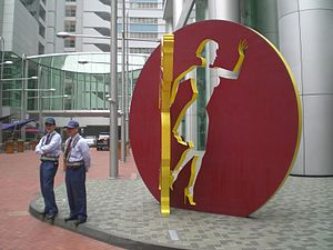 Allen Jones (artist) - Taikoo Place, Hong Kong, showing HK Quarry Bay, Tong Chong Street, Allen Jones' sculpture City Shadow I Security, pictured in 2009.