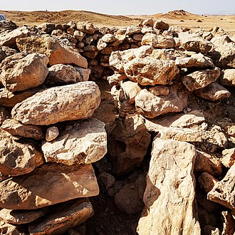 Hafit period - An unrestored Hafit period beehive tomb at Jebel Hafeet in the region of Al-Ain, on the border with Oman. Most of the hundreds of tombs to be found at the Eastern foothills of the mountain have collapsed.