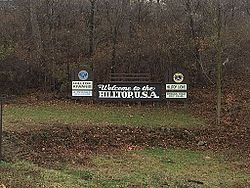 Hilltop, USA sign welcoming visitors to area