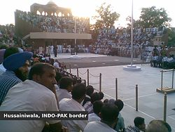 Flag lowering ceremony at Hussainiwala Border, Far side is Pakistan and near side is India