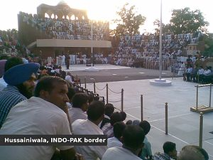 Hussainiwala - Flag lowering ceremony at Hussainiwala Border, Far side is Pakistan and near side is India