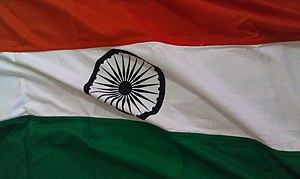 Flag code of India - The Tiranga is colored with saffron as the top band, white band in the centre, dark green band at the bottom and a navy blue Asokha Chakra placed at the centre of the white band.
