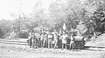 Indonesian and Dutch soldiers taken in front of military jeeps on a railway line (AWM P03170.008).JPG