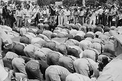 Iranian men bow in prayer during demonstration for Khomeini in Washington, D.C..jpg
