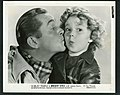 """James Dunn and Shirley Temple publicity photo for """"Bright Eyes"""" - front.jpg"""