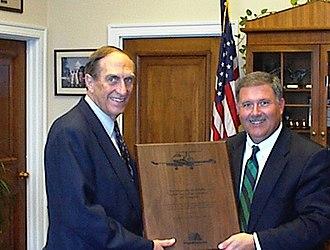 Joel Hefley - Hefley, left, receives an award from the Director of Centennial Airport.