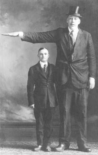 John Aasen - Aasen standing next to an average height man