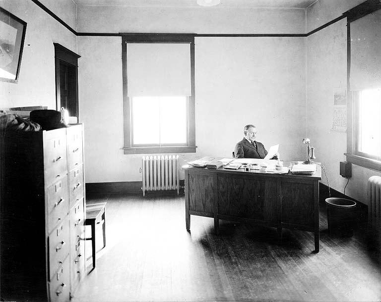 John Cobb in his office, University of Washington campus, nd (COBB 325).jpeg