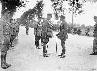 Charles Blackader - King George V (centre-right) speaks with Blackader (centre-left) while visiting the division, 13th August 1916.