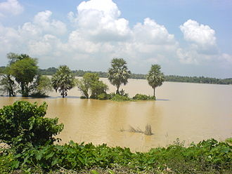 Many areas remain flooded during the heavy rains brought by a monsoon Kalinagar Floods B.JPG