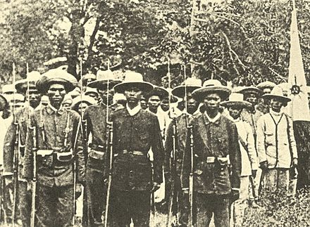Photograph of armed Filipino revolutionaries known as Katipuneros. Katipuneros.jpg