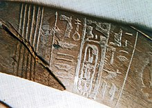 Closeup of the ivory wand showing the king's name.