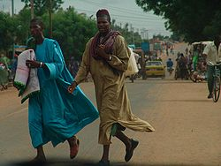 Men cross a busy street in Kayes, 2006.