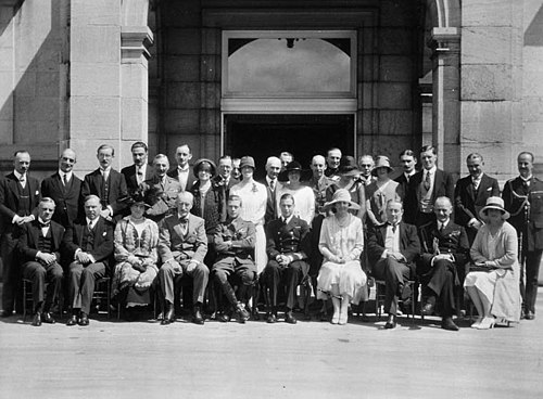 Visit of the Prince of Wales (the future Edward VIII) to Rideau Hall, Ottawa August 1927. Front row: left-right: 2nd, W. L. Mackenzie King; 4th, Viscount Willingdon; 5th, the Prince of Wales; 6th, Prince George; 8th, Baldwin KingRoyals1927.jpg
