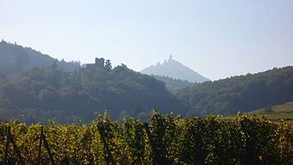 Château de Kintzheim - View of the Château de Kintzheim and of Haut-Koenigsbourg from the road between Châtenois and Kintzheim