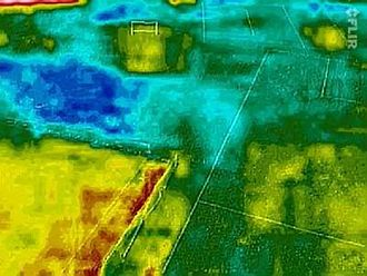 Aerial archaeology - Kite aerial thermogram revealing features on/under a grassed playing field. The relative roles played by thermal inertia, differential transpiration and evaporation are unknown.