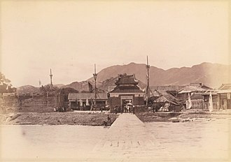 "Lung Tsun Stone Bridge - The Lung Tsun Stone Bridge and the Lung Tsun Pavilion (or the ""Pavilion for Greeting Officials"") of the Kowloon Walled City in 1898."