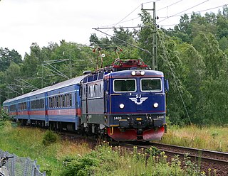 Train A series of rail vehicles, including a locomotive, for transporting cargo and/or passengers