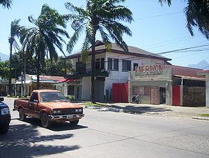 La Ceiba - A shop selling air conditioning. Pico Bonito Mountain in the far right background